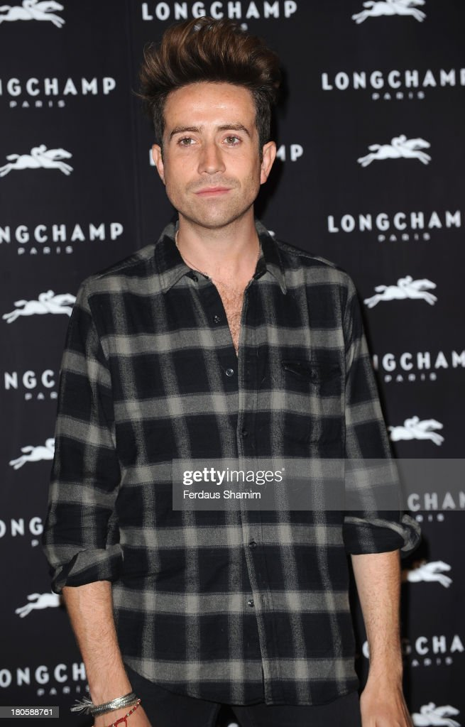 <a gi-track='captionPersonalityLinkClicked' href=/galleries/search?phrase=Nick+Grimshaw&family=editorial&specificpeople=4666727 ng-click='$event.stopPropagation()'>Nick Grimshaw</a> attends the grand opening party of Longchamp Regent Street at Longchamp on September 14, 2013 in London, England.
