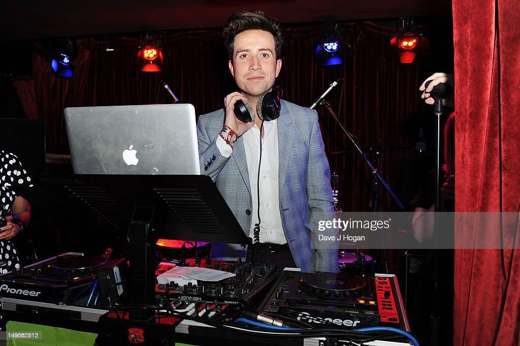 <a gi-track='captionPersonalityLinkClicked' href=/galleries/search?phrase=Nick+Grimshaw&family=editorial&specificpeople=4666727 ng-click='$event.stopPropagation()'>Nick Grimshaw</a> DJ's at the UK Creatives Drinks Reception celebrating media, arts, sport and creativity in the UK at Dover Arts Club on July 30, 2012 in London, England.
