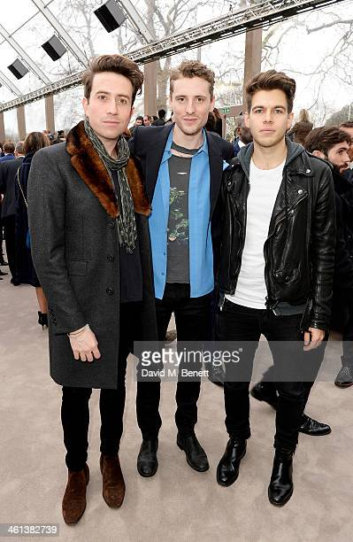 Nick Grimshaw George Barnett and James Righton attend the front row during the Burberry AW14 Menswear Show at Kensington Gardens on January 8 2014 in...