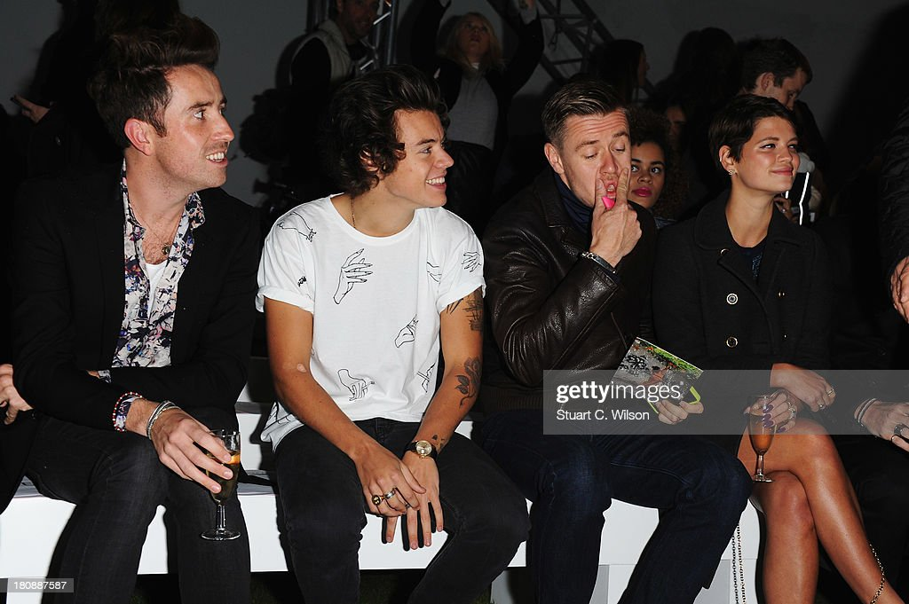Nick Grimshaw, Harry Styles and Pixie Geldof (R) attend the Fashion East show during London Fashion Week SS14 at TopShop Show Space on September 17, 2013 in London, England.