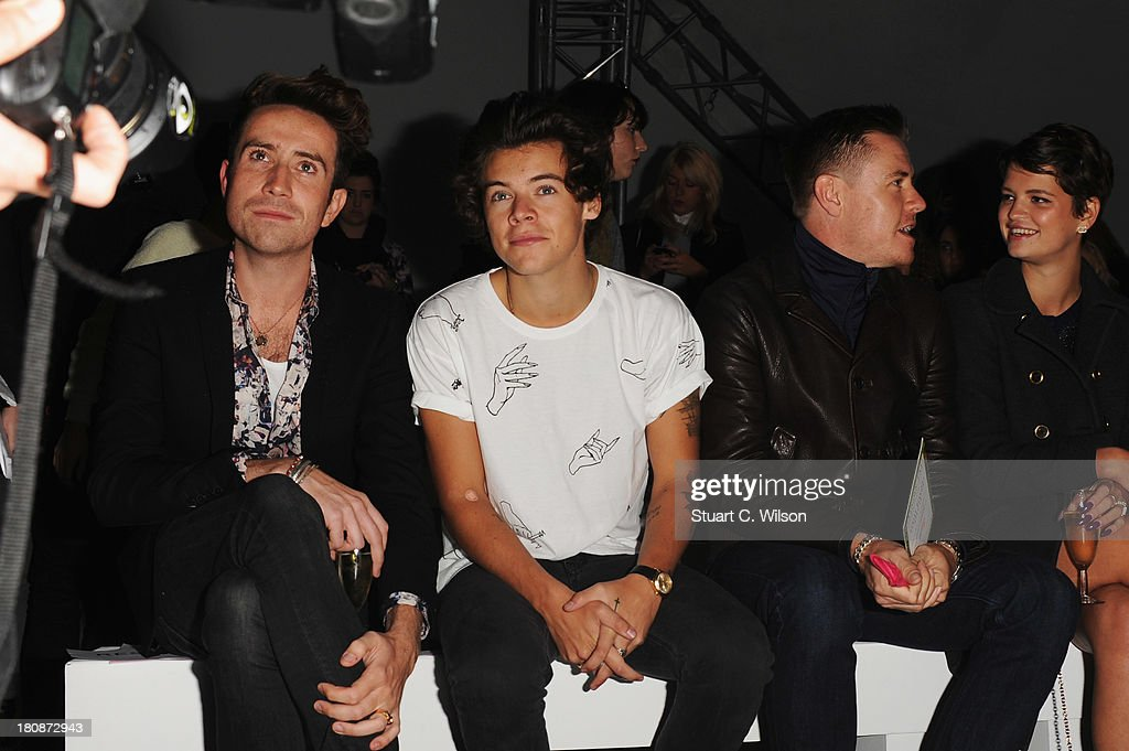 <a gi-track='captionPersonalityLinkClicked' href=/galleries/search?phrase=Nick+Grimshaw&family=editorial&specificpeople=4666727 ng-click='$event.stopPropagation()'>Nick Grimshaw</a>, <a gi-track='captionPersonalityLinkClicked' href=/galleries/search?phrase=Harry+Styles&family=editorial&specificpeople=7229830 ng-click='$event.stopPropagation()'>Harry Styles</a>, guest and <a gi-track='captionPersonalityLinkClicked' href=/galleries/search?phrase=Pixie+Geldof&family=editorial&specificpeople=208703 ng-click='$event.stopPropagation()'>Pixie Geldof</a> attend the Fashion East show during London Fashion Week SS14 at TopShop Show Space on September 17, 2013 in London, England.