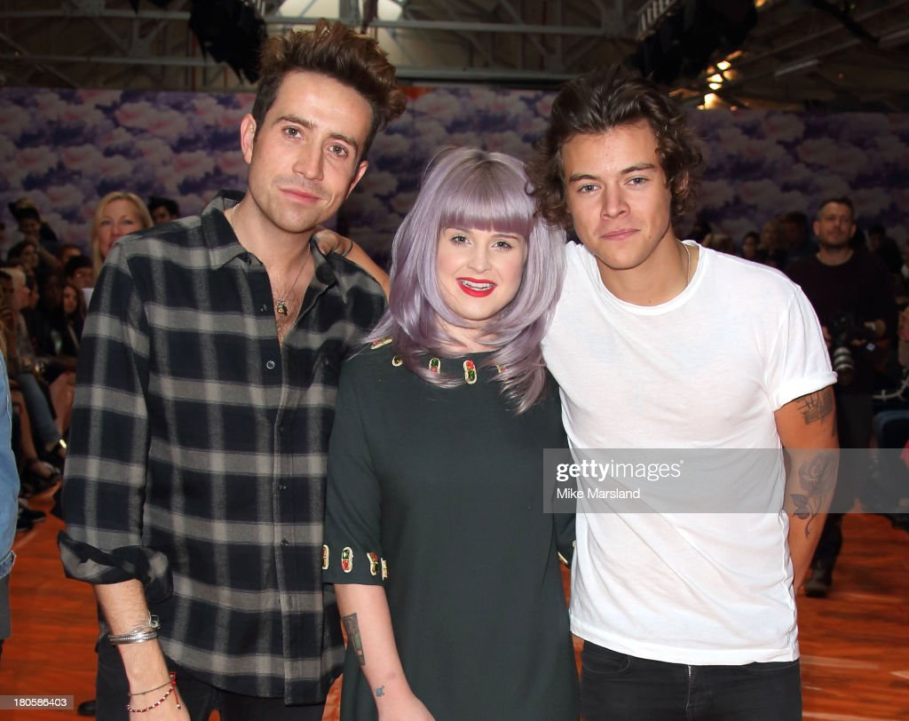 <a gi-track='captionPersonalityLinkClicked' href=/galleries/search?phrase=Nick+Grimshaw&family=editorial&specificpeople=4666727 ng-click='$event.stopPropagation()'>Nick Grimshaw</a>, <a gi-track='captionPersonalityLinkClicked' href=/galleries/search?phrase=Kelly+Osbourne&family=editorial&specificpeople=156416 ng-click='$event.stopPropagation()'>Kelly Osbourne</a> and <a gi-track='captionPersonalityLinkClicked' href=/galleries/search?phrase=Harry+Styles&family=editorial&specificpeople=7229830 ng-click='$event.stopPropagation()'>Harry Styles</a> attend the House Of Holland show at London Fashion Week SS14 on September 14, 2013 in London, England.