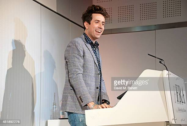 Nick Grimshaw presents the final award at the 2014 Fashion Retail Academy Awards at the Fashion Retail Academy on July 9 2014 in London England