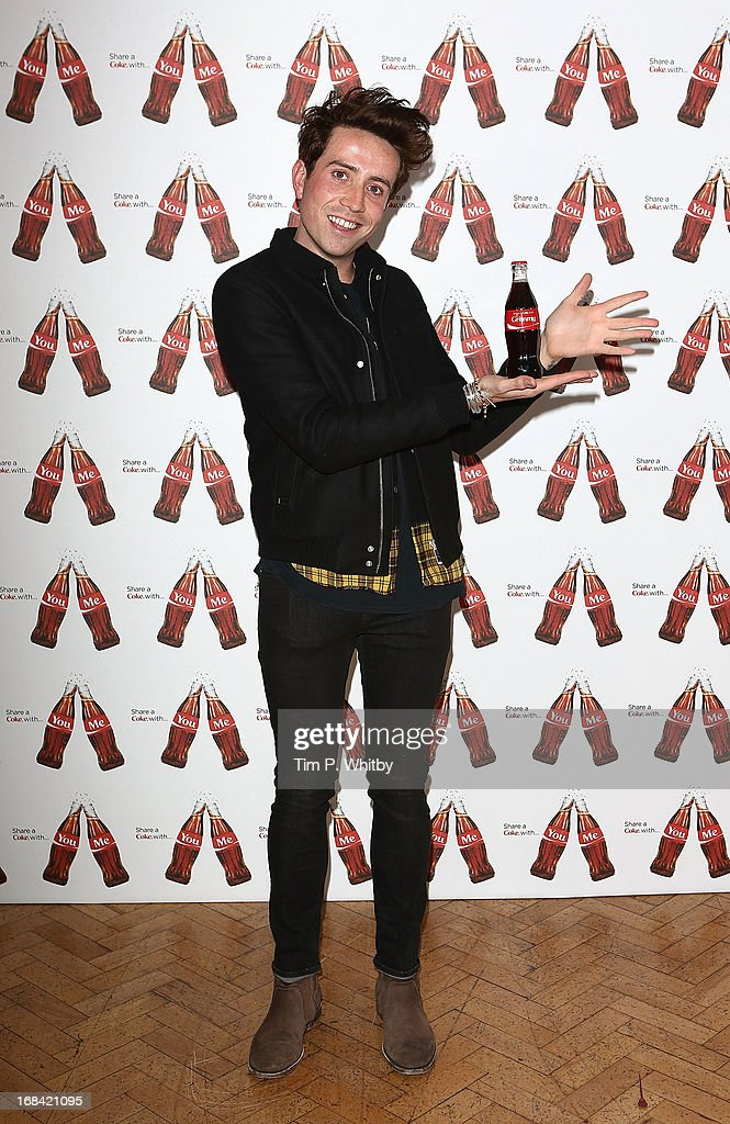 <a gi-track='captionPersonalityLinkClicked' href=/galleries/search?phrase=Nick+Grimshaw&family=editorial&specificpeople=4666727 ng-click='$event.stopPropagation()'>Nick Grimshaw</a> with his personalised Coke bottle at the launch of Coca-Cola's, Share a Coke campaign at One Marylebone on May 9, 2013 in London, England.