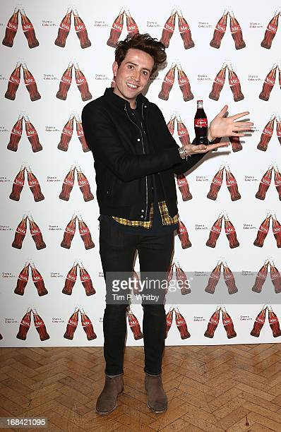 Nick Grimshaw with his personalised Coke bottle at the launch of CocaCola's Share a Coke campaign at One Marylebone on May 9 2013 in London England