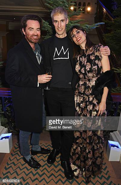 Nick Haddow Clym Evernden and Maria Kastani attend Claridge's Christmas Tree 2016 Party with tree designed by Sir Jony Ive and Marc Newson at...