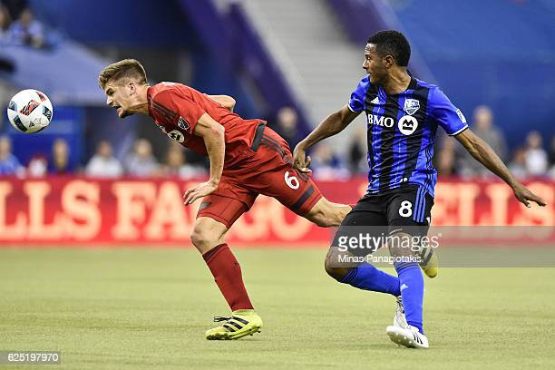 Nick Hagglund of the Toronto FC defends the ball against Patrice Bernier of the Montreal Impact during leg one of the MLS Eastern Conference finals...