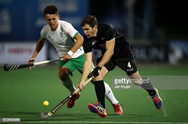 Nick Haig of New Zealand controls the ball from Matthew Nelson of Ireland during day 8 of the FIH Hockey World League Men's Semi Finals 5th/ 6th...
