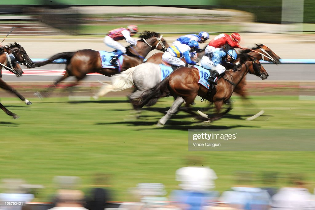 Nick Hall riding Oriental Ruby (10) races down the middle to win the Adapt Australia Handicap during Melbourne racing at Moonee Valley Racecourse on December 29, 2012 in Melbourne, Australia.