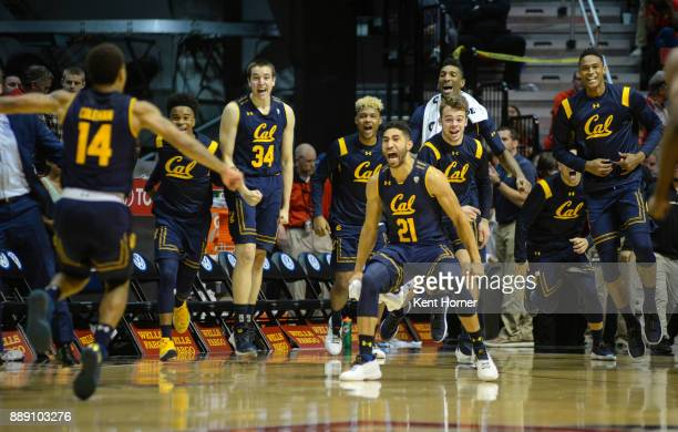 Nick Hamilton and Don Coleman of the California Golden Bears celebrate after beating the San Diego State Aztcs at Viejas Arena on December 9 2017 in...