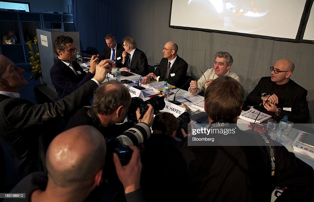 Nick Hayek, chief executive officer of Swatch AG, second right, poses for photographers during the company's annual results news conference in Grenchen, Switzerland, on Wednesday, March 6, 2013. Swatch Group AG, the biggest maker of Swiss timepieces, fell as much as 3.1 percent in Zurich trading after Hayek sought to downplay expectations over industry growth prospects. Photographer: Gianluca Colla/Bloomberg via Getty Images