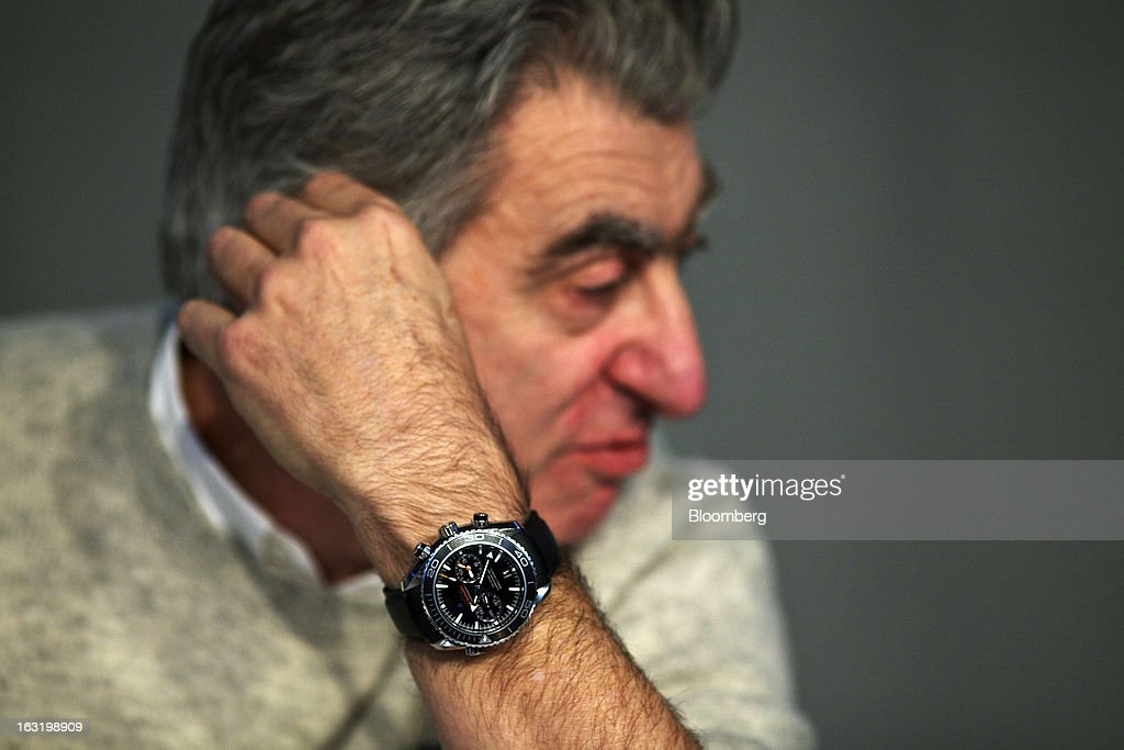Nick Hayek, chief executive officer of Swatch AG, wears an Omega Seamaster Professional wristwatch during the company's annual results news conference in Grenchen, Switzerland, on Wednesday, March 6, 2013. Swatch Group AG, the biggest maker of Swiss timepieces, fell as much as 3.1 percent in Zurich trading after Hayek sought to downplay expectations over industry growth prospects. Photographer: Gianluca Colla/Bloomberg via Getty Images
