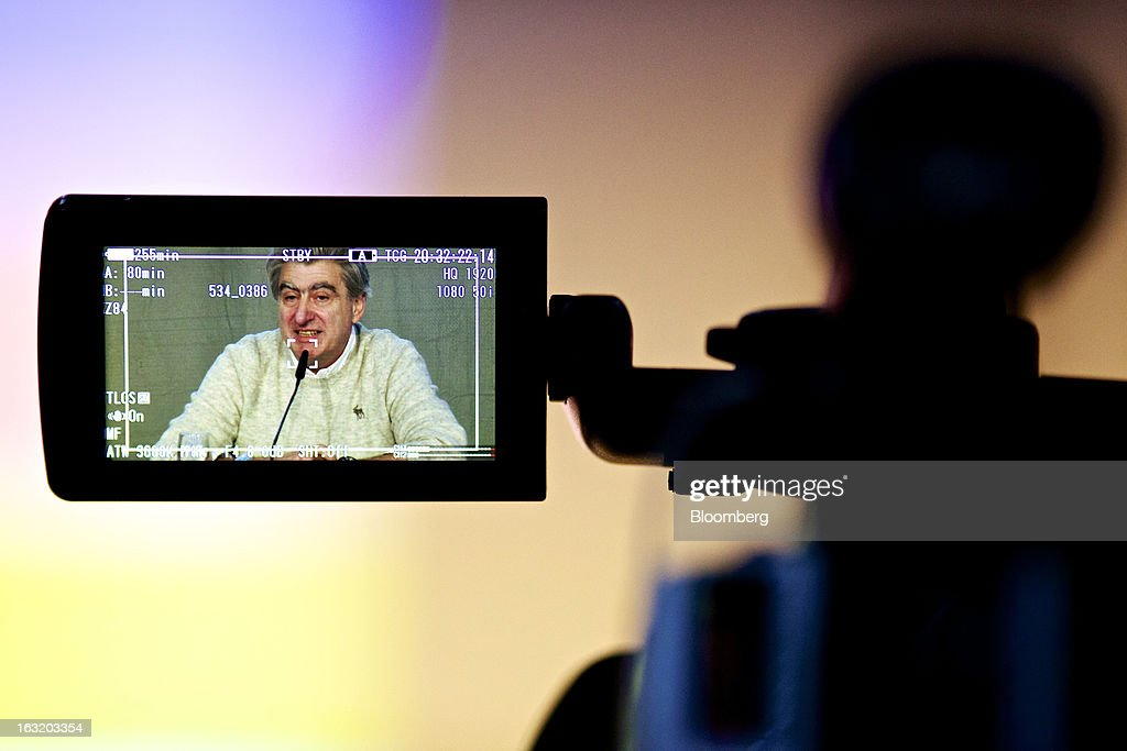 Nick Hayek, chief executive officer of Swatch Group AG, is seen on the display of a television camera as he speaks during the company's annual results news conference in Grenchen, Switzerland, on Wednesday, March 6, 2013. Swatch Group AG, the biggest maker of Swiss timepieces, fell as much as 3.1 percent in Zurich trading after Hayek sought to downplay expectations over industry growth prospects. Photographer: Gianluca Colla/Bloomberg via Getty Images