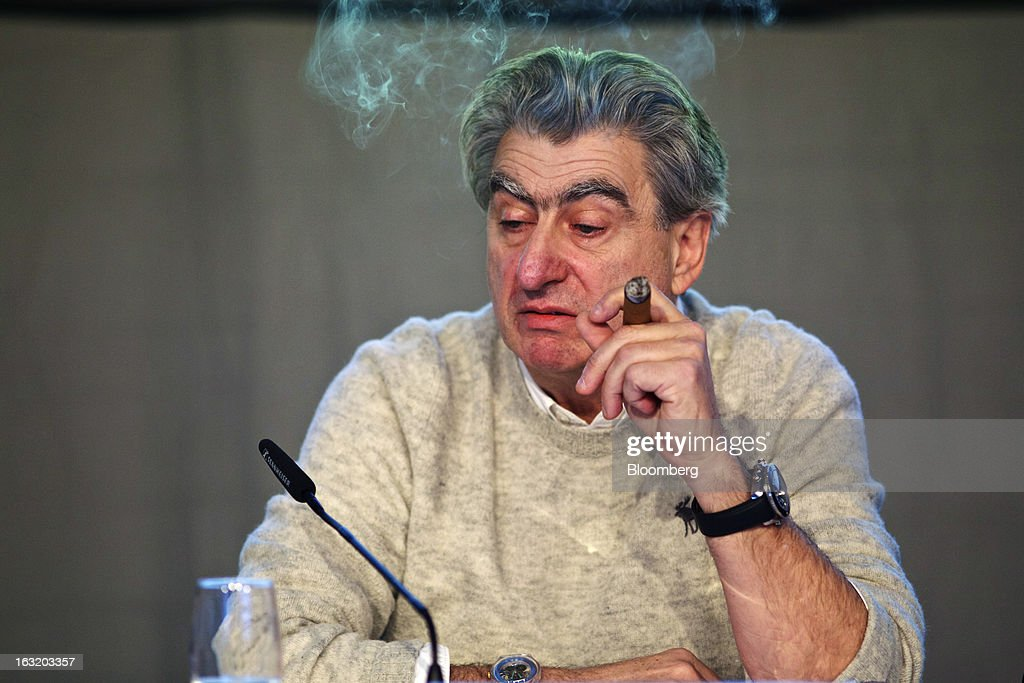 Nick Hayek, chief executive officer of Swatch Group AG, smokes a cigar during the company's annual results news conference in Grenchen, Switzerland, on Wednesday, March 6, 2013. Swatch Group AG, the biggest maker of Swiss timepieces, fell as much as 3.1 percent in Zurich trading after Hayek sought to downplay expectations over industry growth prospects. Photographer: Gianluca Colla/Bloomberg via Getty Images