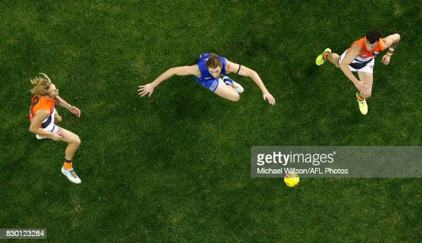 Nick Haynes and Zac Williams of the Giants compete for the ball against Marcus Bontempelli of the Bulldogs during the 2017 AFL round 21 match between...