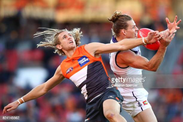 Nick Haynes of the Giants and Nick Fyfe contest the ball in the air during the round 19 AFL match between the Greater Western Sydney Giants and the...
