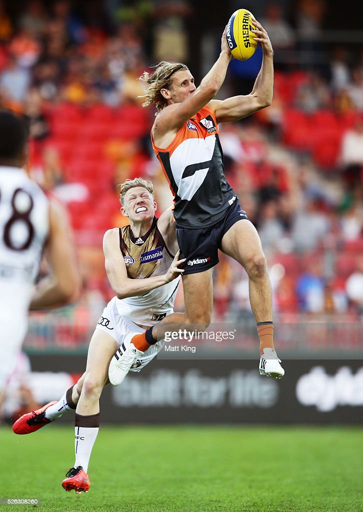 Nick Haynes of the Giants takes a mark under pressure from James Sicily of the Hawks during the round six AFL match between the Greater Western Sydney Giants and the Hawthorn Hawks at Spotless Stadium on April 30, 2016 in Sydney, Australia.