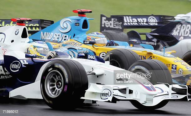 Nick Heidfeld of Germany and BMW Sauber in action next to Fernando Alonso of Spain and Renault during the Hungarian Formula One Grand Prix at the...