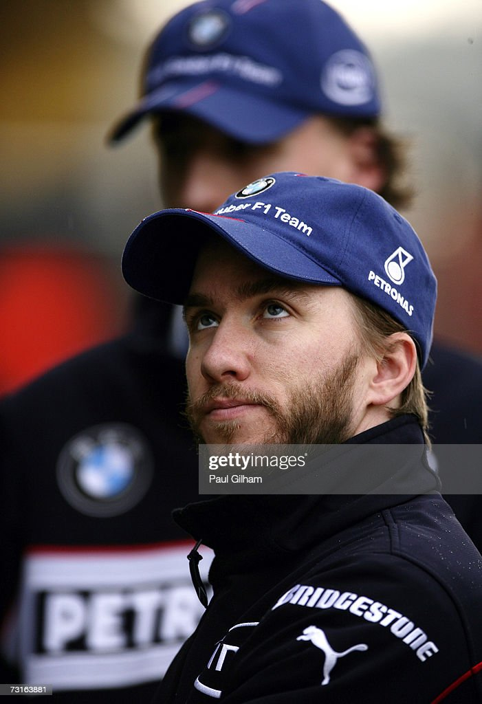 Nick Heidfeld of Germany and BMW Sauber looks on in the pitlane during Formula One testing at the Circuit Ricardo Tormo on January 31 2007 in...