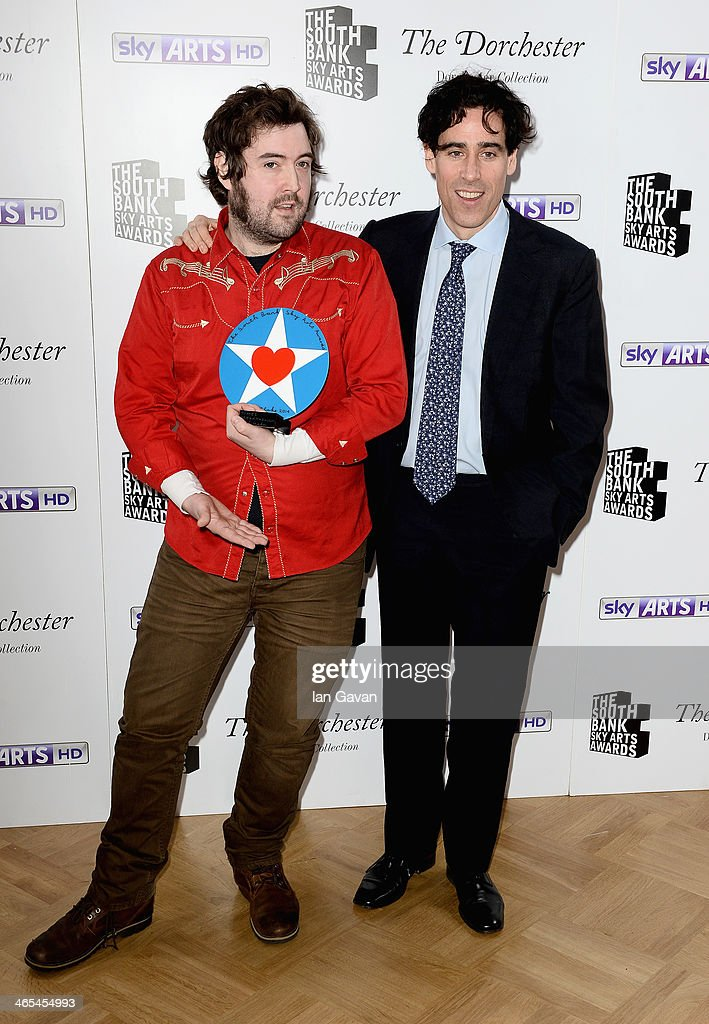 Nick Helm with his Breakthrough award with presenter <a gi-track='captionPersonalityLinkClicked' href=/galleries/search?phrase=Stephen+Mangan&family=editorial&specificpeople=227894 ng-click='$event.stopPropagation()'>Stephen Mangan</a> during the South Bank Sky Arts awards at the Dorchester Hotel on January 27, 2014 in London, England.