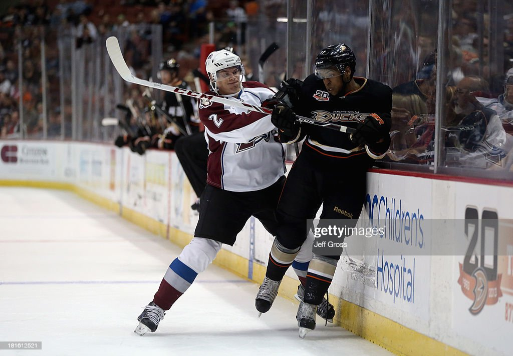 Nick Holden #2 of the Colorado Avalanche checks <a gi-track='captionPersonalityLinkClicked' href=/galleries/search?phrase=Devante+Smith-Pelly&family=editorial&specificpeople=6340107 ng-click='$event.stopPropagation()'>Devante Smith-Pelly</a> #77 of the Anaheim Ducks into the boards in the second period at Honda Center on September 22, 2013 in Anaheim, California.