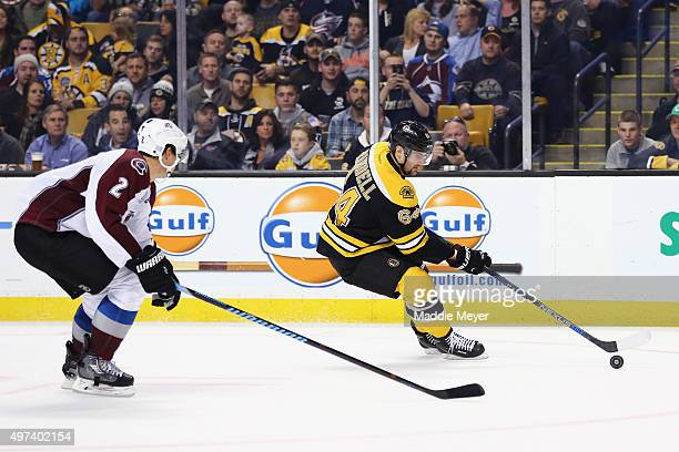 Nick Holden of the Colorado Avalanche defends Tyler Randell of the Boston Bruins during the third period at TD Garden on November 12 2015 in Boston...