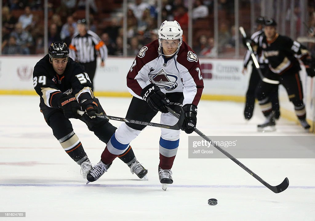 Nick Holden #2 of the Colorado Avalanche is pursued by <a gi-track='captionPersonalityLinkClicked' href=/galleries/search?phrase=Daniel+Winnik&family=editorial&specificpeople=2529214 ng-click='$event.stopPropagation()'>Daniel Winnik</a> #34 of the Anaheim Ducks for the puck in the first period at Honda Center on September 22, 2013 in Anaheim, California. The Avalanche defeated the Ducks 2-1.