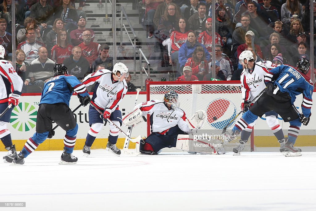 <a gi-track='captionPersonalityLinkClicked' href=/galleries/search?phrase=Nick+Holden&family=editorial&specificpeople=5635993 ng-click='$event.stopPropagation()'>Nick Holden</a> #2 of the Colorado Avalanche scores his first goal in the NHL against the Washington Capitals at the Pepsi Center on November 10, 2013 in Denver, Colorado.