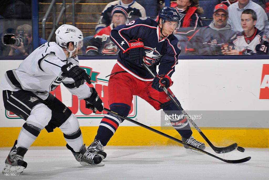 Nick Holden #29 of the Columbus Blue Jackets shoots the puck in the third period as Jake Muzzin #6 of the Los Angeles Kings defends on February 5, 2013 at Nationwide Arena in Columbus, Ohio. Los Angeles defeated Columbus 4-2.