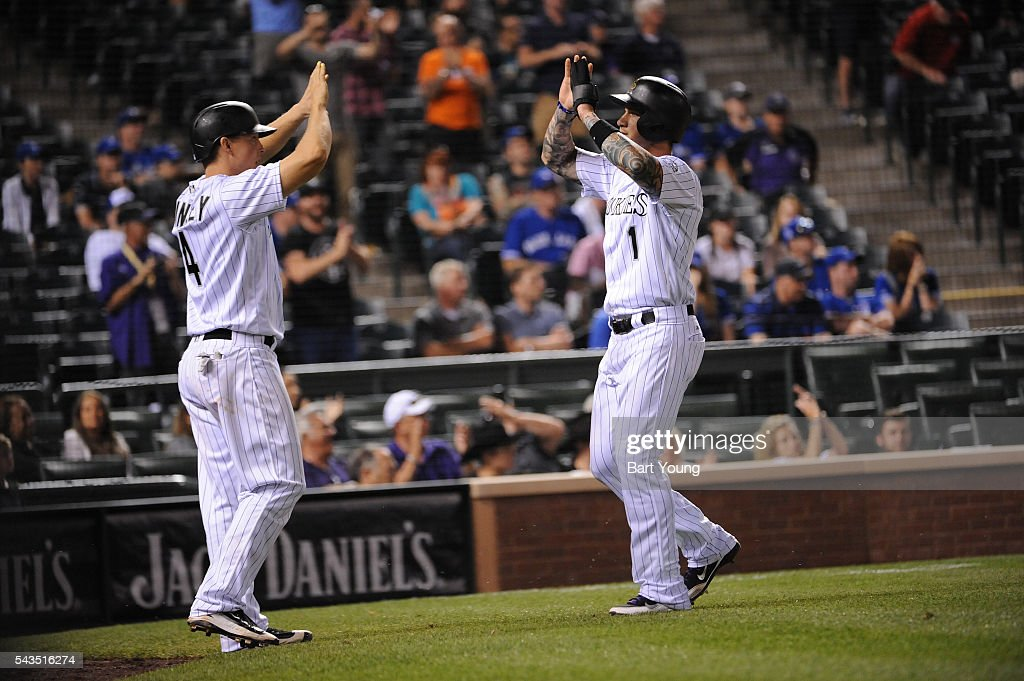 Nick Hundley #4 and Brandon Barnes #1 of the Colorado Rockies celebrate their runs in the seventh inning against the Toronto Blue Jays at Coors Field on June 28, 2016 in Denver, Colorado. The Toronto Blue Jays defeat the Colorado Rockies 14-9.