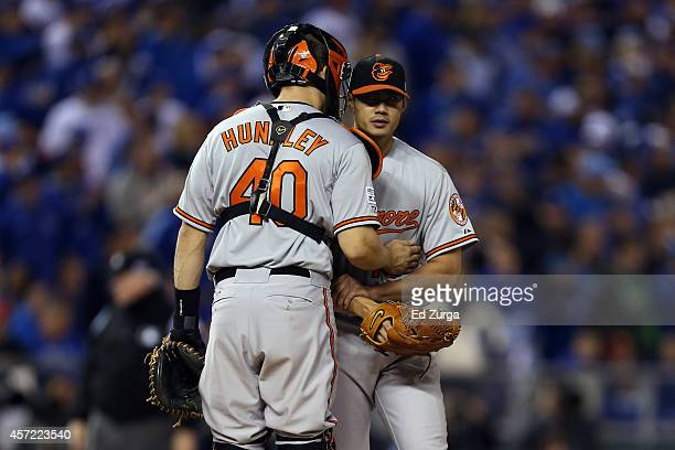 Nick Hundley of the Baltimore Orioles talks with starting pitcher WeiYin Chen in the fourth inning against the Kansas City Royals during Game Three...