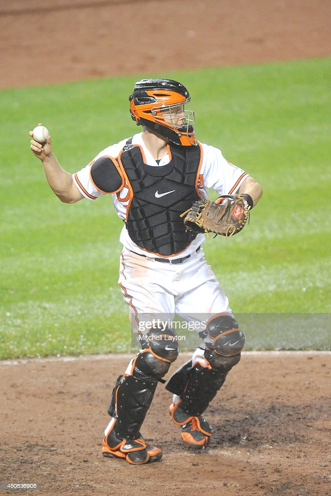 Nick Hundley #40 of the Baltimore Orioles throws to second base during a baseball game against the Boston Red Sox on June 11, 2014 at Oriole Park at Camden Yards in Baltimore, Maryland. The Orioles won 6-0.