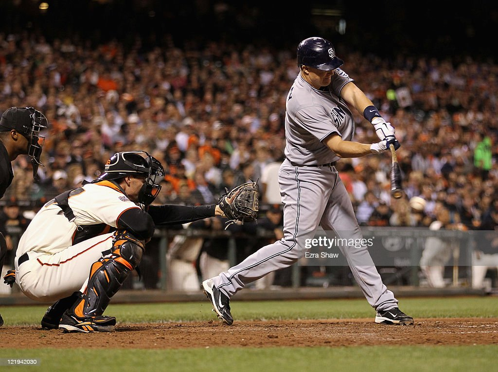 <a gi-track='captionPersonalityLinkClicked' href=/galleries/search?phrase=Nick+Hundley&family=editorial&specificpeople=4175399 ng-click='$event.stopPropagation()'>Nick Hundley</a> #4 of the San Diego Padres hits a fielders choice that scored Orlando Hudson #1 in the seventh inning against the San Francisco Giants at AT&T Park on August 23, 2011 in San Francisco, California.