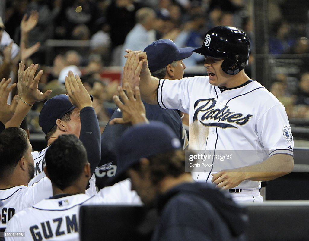 <a gi-track='captionPersonalityLinkClicked' href=/galleries/search?phrase=Nick+Hundley&family=editorial&specificpeople=4175399 ng-click='$event.stopPropagation()'>Nick Hundley</a> #4 of the San Diego Padres is congratulated after scoring in the seventh inning against the Colorado Rockies at Petco Park on April 12, 2013 in San Diego, California.