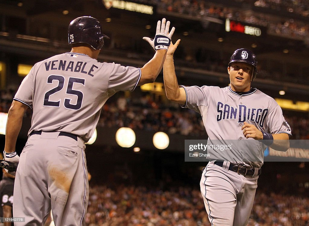 <a gi-track='captionPersonalityLinkClicked' href=/galleries/search?phrase=Nick+Hundley&family=editorial&specificpeople=4175399 ng-click='$event.stopPropagation()'>Nick Hundley</a> #4 of the San Diego Padres is congratulated by <a gi-track='captionPersonalityLinkClicked' href=/galleries/search?phrase=Will+Venable&family=editorial&specificpeople=3068470 ng-click='$event.stopPropagation()'>Will Venable</a> #25 after he scored the go ahead run in the ninth inning of their game against the San Francisco Giants at AT&T Park on August 23, 2011 in San Francisco, California.
