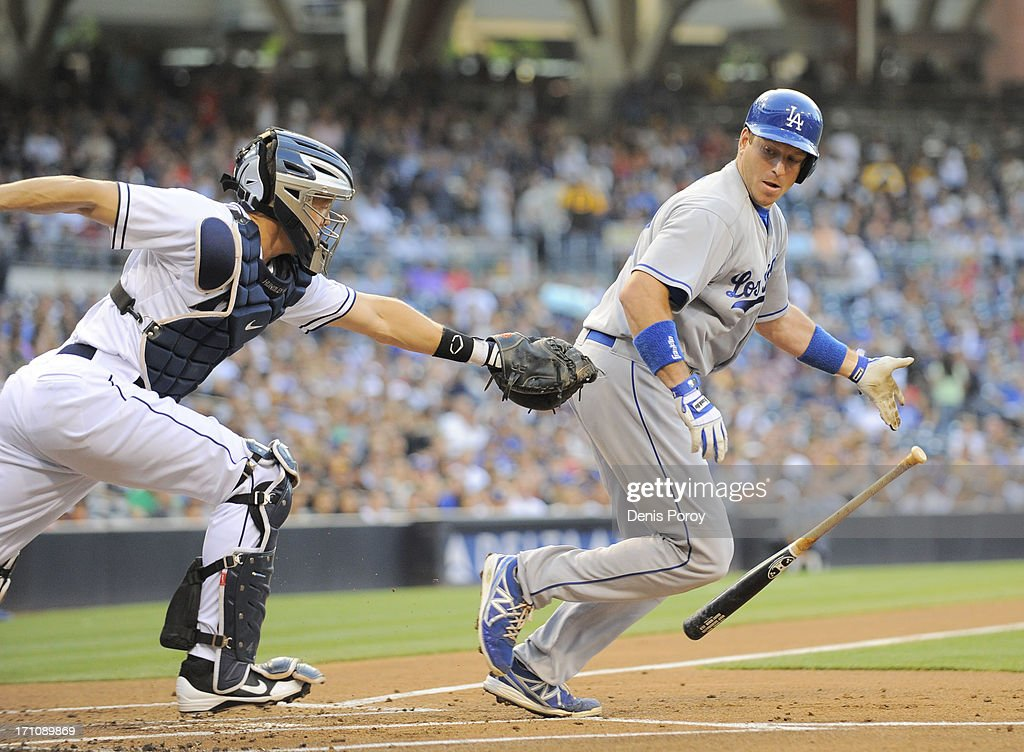 <a gi-track='captionPersonalityLinkClicked' href=/galleries/search?phrase=Nick+Hundley&family=editorial&specificpeople=4175399 ng-click='$event.stopPropagation()'>Nick Hundley</a> #4 of the San Diego Padres reaches out to tag <a gi-track='captionPersonalityLinkClicked' href=/galleries/search?phrase=Mark+Ellis+-+Baseball+Player&family=editorial&specificpeople=213759 ng-click='$event.stopPropagation()'>Mark Ellis</a> #14 of the Los Angeles Dodgers during the first inning of a baseball game at Petco Park on June 21, 2013 in San Diego, California. Ellis was thrown out at first base.