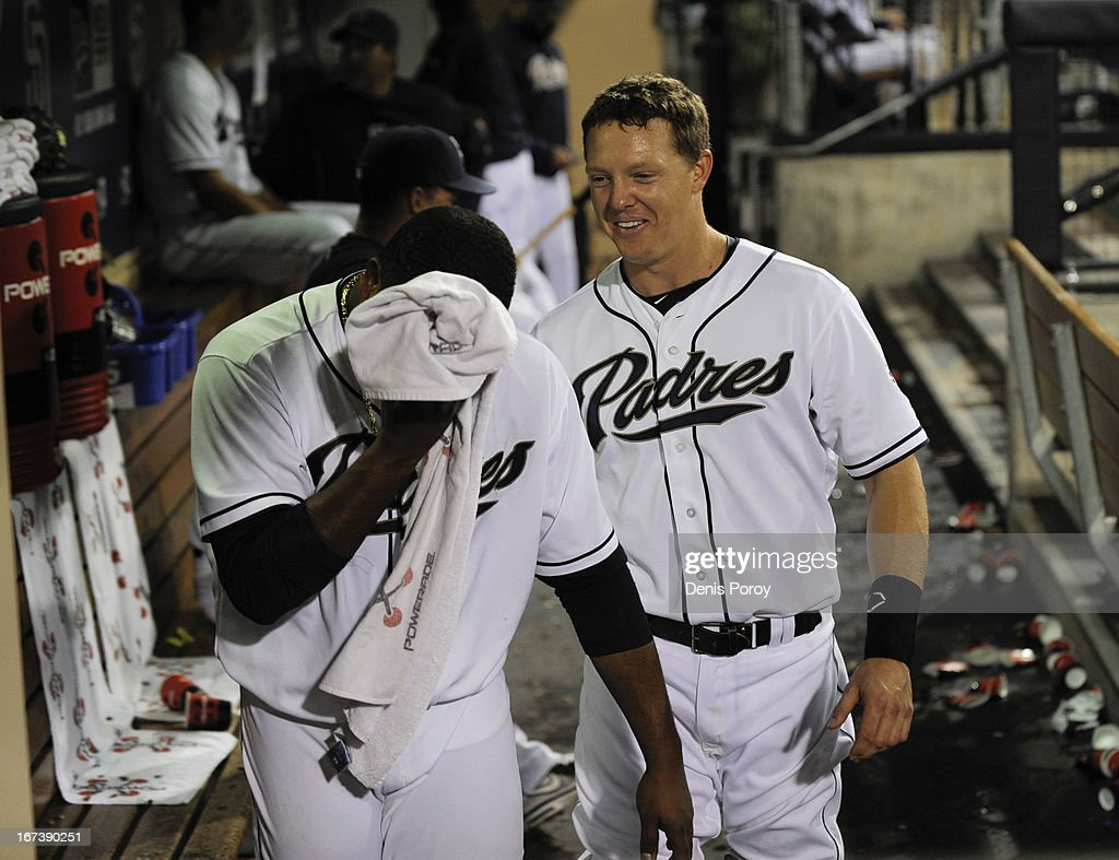 Nick Hundley #4 of the San Diego Padres, right, jokes with Edinson Volquez #37, left, in the dugout during the eighth inning of a baseball game against the Milwaukee Brewers at Petco Park on April 24, 2013 in San Diego, California. The Padres won 2-1.