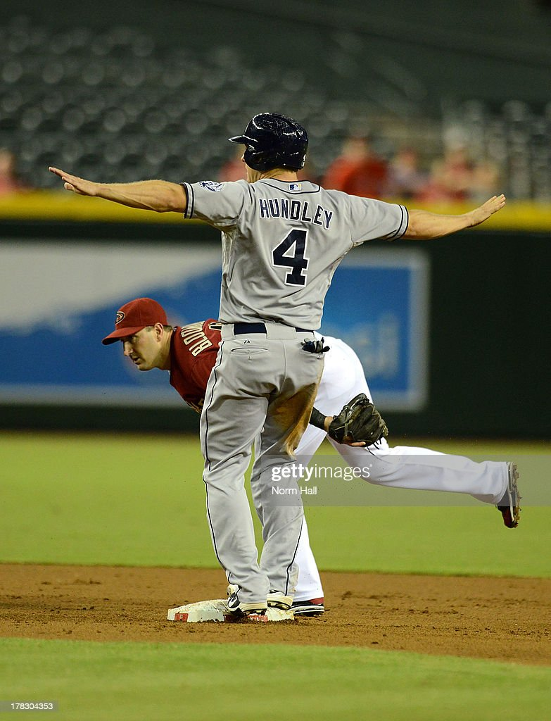 <a gi-track='captionPersonalityLinkClicked' href=/galleries/search?phrase=Nick+Hundley&family=editorial&specificpeople=4175399 ng-click='$event.stopPropagation()'>Nick Hundley</a> #4 of the San Diego Padres signals himself safe at second base in front of <a gi-track='captionPersonalityLinkClicked' href=/galleries/search?phrase=Willie+Bloomquist&family=editorial&specificpeople=214000 ng-click='$event.stopPropagation()'>Willie Bloomquist</a> #18 of the Arizona Diamondbacks at Chase Field on August 28, 2013 in Phoenix, Arizona.