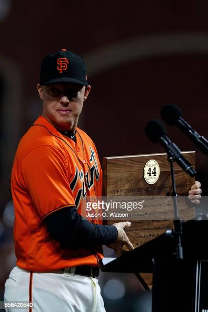 Nick Hundley of the San Francisco Giants accepts the 2017 Willie Mac Award before the game against the San Diego Padres at ATT Park on September 29...