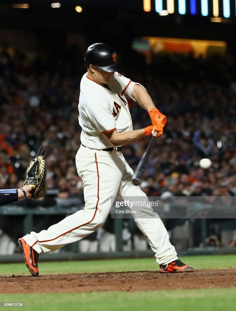 Nick Hundley #5 of the San Francisco Giants hits a ground out that scored in a run in the fourth inning against the Milwaukee Brewers at AT&T Park on August 21, 2017 in San Francisco, California.