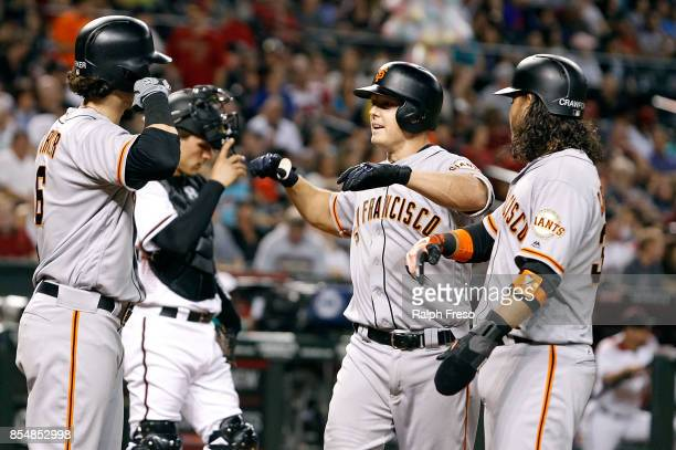 Nick Hundley of the San Francisco Giants is congratulated by teammates Jarrett Parker and Brandon Crawford after hitting a threerun home run against...