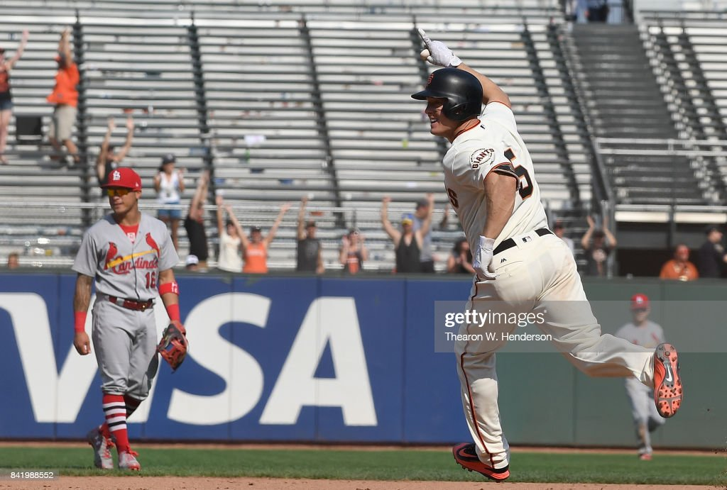 Nick Hundley #5 of the San Francisco Giants trots around the bases celebrating after he hit a walk off solo home run against the St. Louis Cardinals in the bottom of the tenth inning at AT&T Park on September 2, 2017 in San Francisco, California. The Giants won the game 2-1.