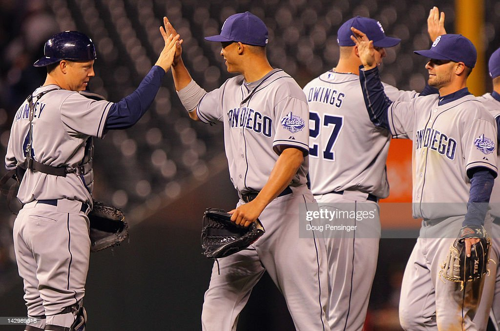 Nick Hundley #4, Will Venable #25, Micah Owings #27 and Jason Bartlett #8 of the San Diego Padres celebrate their 7-1 win over the Colorado Rockies at Coors Field on April 16, 2012 in Denver, Colorado.
