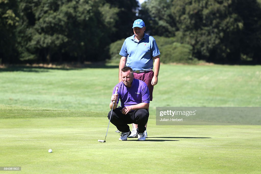 Nick James looks on as his partner Robert Selley of Teignmouth Golf Club lines up a putt during The PGA ProCaptain South West Qualifier at Bowood...