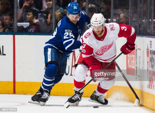 Nick Jensen of the Detroit Red Wings battles for the puck with William Nylander of the Toronto Maple Leafs during the third period at the Air Canada...