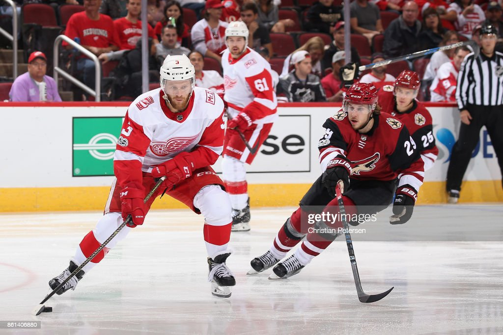 Nick Jensen #3 of the Detroit Red Wings saktes with the puck ahead of Mario Kempe #29 of the Arizona Coyotes during the third period of the NHL game at Gila River Arena on October 12, 2017 in Glendale, Arizona. The Red Wings defeated the Coyotes 4-2.