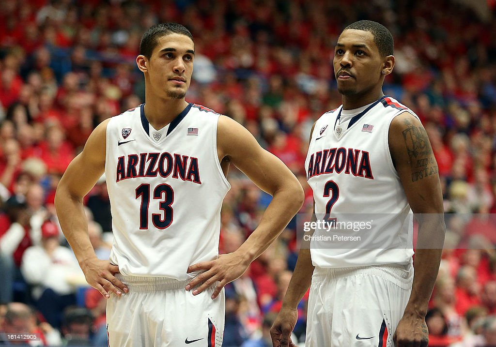 Nick Johnson #13 and Mark Lyons #2 of the Arizona Wildcats react during the college basketball game against the California Golden Bears at McKale Center on February 10, 2013 in Tucson, Arizona. The Golden Bears defeated the Wildcats 77-69.