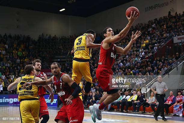 Nick Johnson of Muenchen is challenged by Tekele Cotton of Ludwigsburg during the easyCredit BBL match between MHP Riesen Ludwigsburg and FC Bayern...