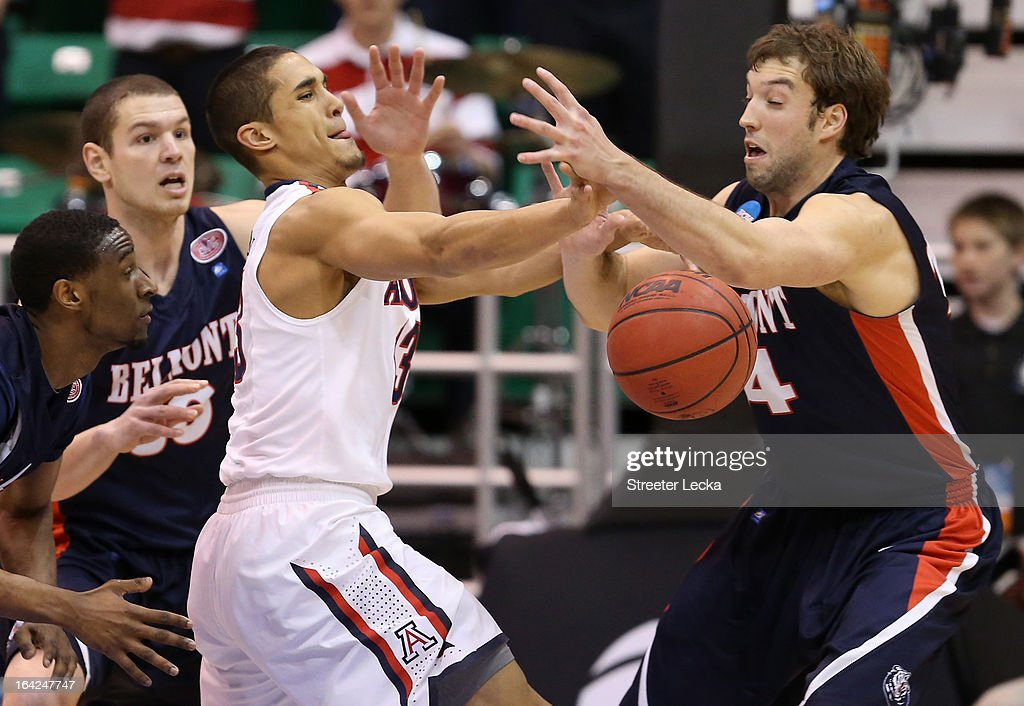 Nick Johnson of the Arizona Wildcats and JJ Mann of the Belmont Bruins battle for a loose ball in the second half during the second round of the 2013...