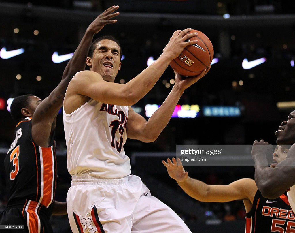 Nick Johnson #13 of the Arizona Wildcats goes up for a shot against Ahmad Starks #3 of the Oregon State Beavers in the second half in the semifinals of the 2012 Pacific Life Pac-12 men's basketball tournament at Staples Center on March 9, 2012 in Los Angeles, California.